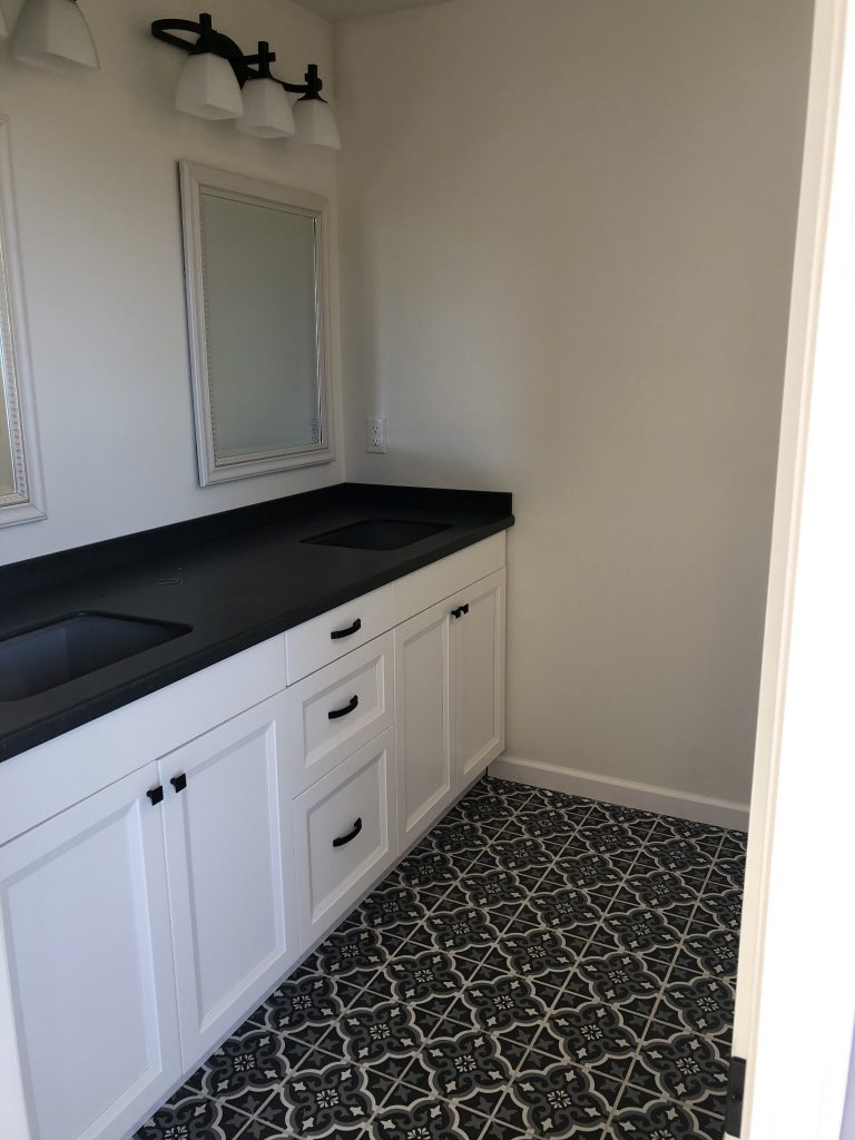 Northland Homes Master Bathroom Vanity with Granite Top and Double Sink